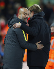 Manchester City manager Pep Guardiola with Liverpool manager Juergen Klopp before the match