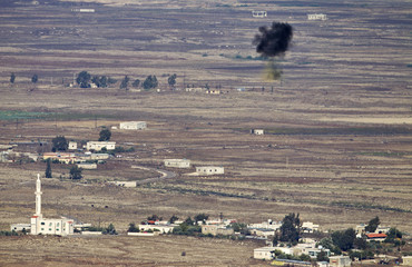 A shell explodes in the air near the Syrian village of Bariqa close to the ceasefire line between Israel and Syria on the Golan Heights