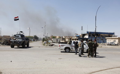 Iraqi security and members of the Hashid Shaabi are seen in Tikrit