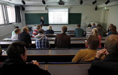 Students attend a class in nuclear engineering at Aalto University School of Science and Technology in Helsinki
