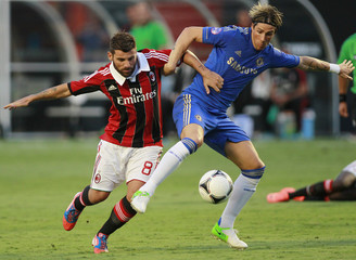 A.C Milan's Nocerino fights for possession against Chelsea's Torres during their match as part of the World Football Challenge in Miami Gardens