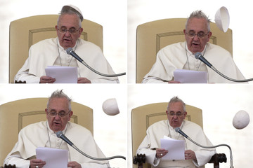 A combination picture of Pope Francis as a gust of wind blows his skull cap off as he leads the general audience in Saint Peter's Square at the Vatican