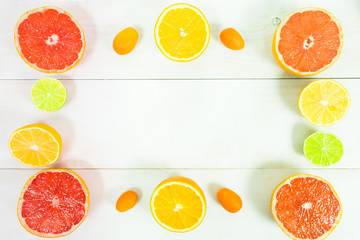 Different citrus like frame on white table