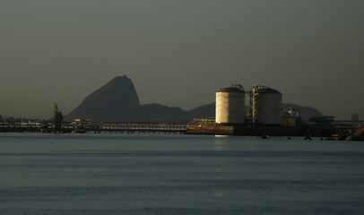 Natural gas storage tanks are pictured at Guanabara Bay with the Sugar Loaf mountain in the background in the state of Rio de Janeiro