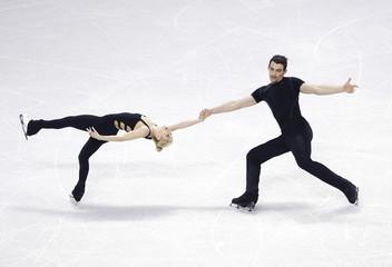 Knierim and Scimeca of the US skate during practice sessions at the ISU World Figure Skating Championships in London
