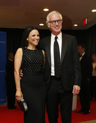 Actress Julia Louis-Dreyfus and her husband Brad Hall arrive on the red carpet at the annual White House Correspondents' Association Dinner in Washington