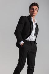 side view of an elegant man in tuxedo walking