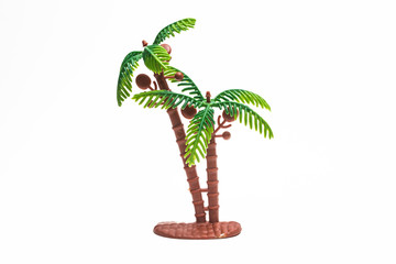 Palm tree plastic toy image on white background