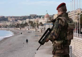 """A French soldier stands guard on the Promenade Des Anglais as part of the """"Vigipirate"""" security plan in Nice"""