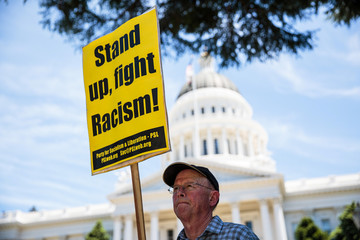 Richard Becker protests after multiple people were stabbed during a clash between neo-Nazis holding a permitted rally and counter-protestors on Sunday at the state capitol in Sacramento.