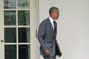 U.S. President Barack Obama walks from the Oval Office of the White House in Washington before his departure to New York