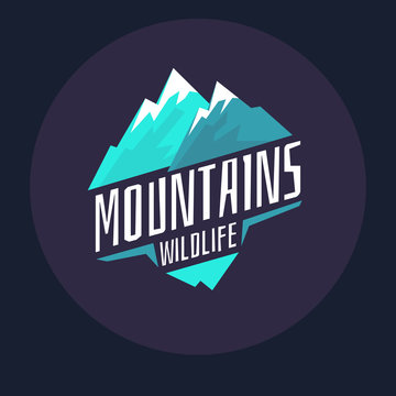 Modern logo mountains with snow in the circle on a dark background