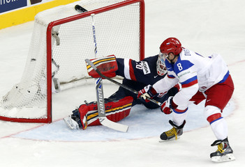 Russia's Ovechkin scores a penalty past goaltender Thomas of the U.S. during the first period of their men's ice hockey World Championship group B game at Minsk Arena in Minsk