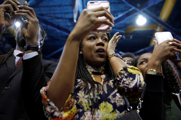 A woman wipes away tears as Obama delivers remarks at a campaign event in Miami
