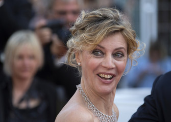 """Cast member Margherita Buy poses on the red carpet as she arrives for screening of the film """"Mia madre"""" in competition at the 68th Cannes Film Festival in Cannes"""