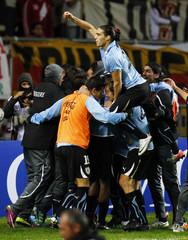 Uruguayan players celebrate the first goal of Suarez against Peru in their semi-final soccer match at the Copa America in La Plata