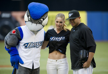 Victoria's Secret model Kroes poses with the Blue Jays mascot and pitcher Romero before they play the Indians in their American League MLB baseball game in Toronto