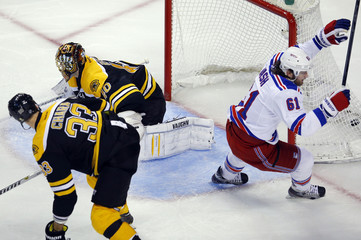 Rangers' Nash celebrates after scoring a goal against Bruins goaltender Rask and Chara in the second period of Game 2 of their NHL Eastern Conference semi-final hockey playoff series