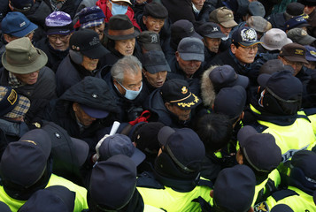 Police officers block anti-North Korean activists trying to enter the office of Korea Alliance, a pro-unification civic group, during a rally in Seoul
