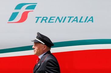 A Trenitalia's conductor walks next to Frecciargento's train at the Vatican railway station in Vatican