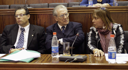 Members of the Mercosur Parliament Araceli Ferreyra of Argentina, Senator Anibal Pereira of Uruguay  and Jorge Mazzarovich of Uruguay look on during a meeting with their Paraguayan colleagues in Asuncion