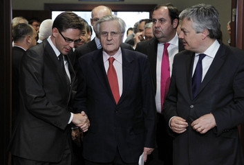 Finnish Finance Minister Katainen, ECB President Trichet, Austrian Finance Minister Proell and Belgian counterpart Reynders arrive at an eurozone finance ministers meeting in Brussels