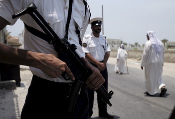 Policemen are seen guarding an entrance leading towards a Shi'ite mosque in the village of Diraz, west of Manama