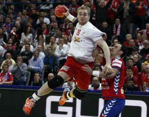 Denmark's Toft Hansen attempts to score during the men's European Handball Championship final match against Denmark in Belgrade