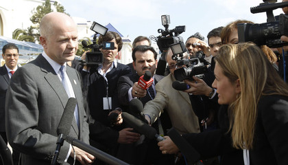 "British Foreign Secretary William Hague speaks to reporters at the ""Friends of Syria"" conference in Tunis"