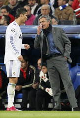 Real Madrid's coach Mourinho speaks to Ronaldo during their Champions League Group G soccer match against AC Milan in Madrid