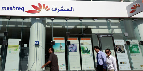 People walk past a branch of Mashreq Bank along Khalid Bin Al-Waleed Road in Dubai