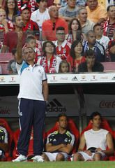 Real Madrid's coach Jose Mourinho gives instructions to his players during their friendly soccer match against Benfica at the Luz stadium in Lisbon