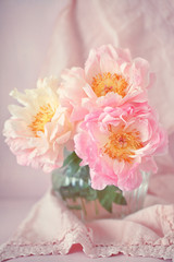 Lovely bunch of flowers .Close-up floral composition with a pink peonies on a table.