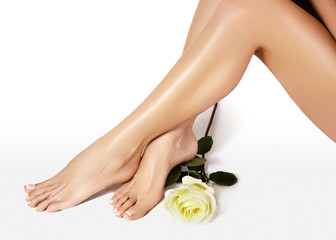 Female legs after depilation. Healthcare, foot care, rutine treatment. Spa and epilation. Feet with clean smooth skin.