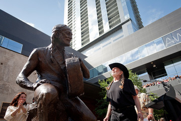 Singer Willie Nelson looks at a statue of himself during its unveiling in downtown Austin