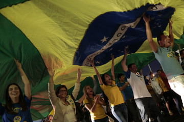 Supporters of Brazilian Social Democratic Party Presidential candidate Aecio Neves take part during a march in his support in Brasilia