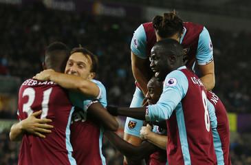 West Ham United's Michail Antonio celebrates scoring their third goal with team mates