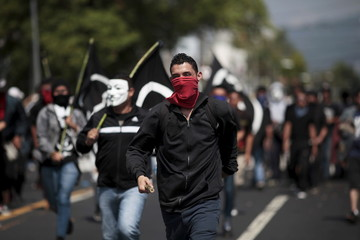 Students march during the May Day celebration in San Salvador
