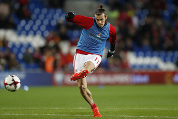 Wales' Gareth Bale warms up before the match