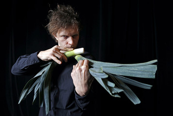 Austrian musician Matthias Meinharter poses for a picture with a musical instrument made from vegetables in Haguenau, eastern France