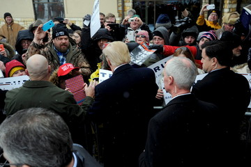 U.S. Republican presidential candidate Trump greets supporters outside the John Wayne Birthplace and Museum after a news conference in Winterset, Iowa