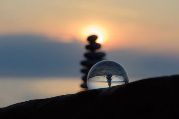 Stones and crystal ball in evening