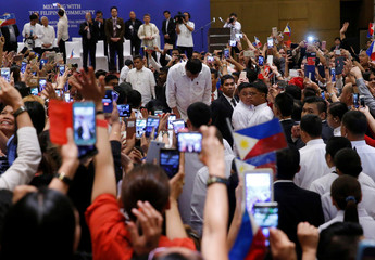 Philippines President Rodrigo Duterte bows as he arrives to meet with the Filipino community during his official visit in Kuala Lumpur