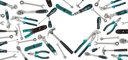 Heart shaped of service tools on white background.