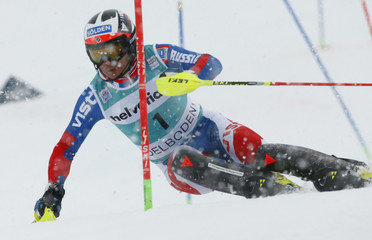 Khoroshilov of Russia  clears a pole during the first run of the men's Slalom Alpine Skiing World Cup race in Adelboden