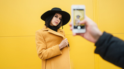 Person taking shot of stylish woman Wall mural