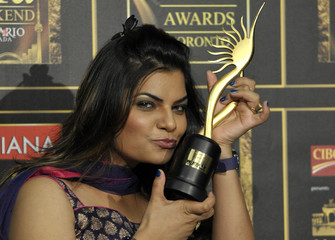 "Singer Sharma holds her award for Best Playback Singer for her song Munni Badnam from the movie ""Dabangg"" during the International Indian Film Academy (IIFA) Awards in Toronto"