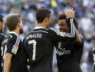 Real Madrid's Cristiano Ronaldo celebrates scoring his second goal against Espanyol with teammate Marcelo  during their Spanish first division soccer match at Power8 stadium in Cornella de Llobregat near Barcelona