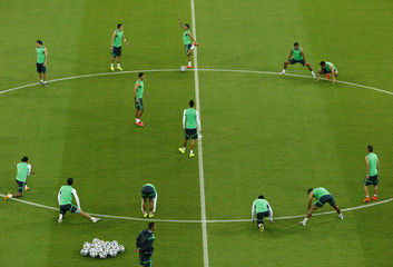Mexico's national soccer team warm up during a training session at the Arena Pernambuco in Recife