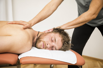 young man at the physio therapy